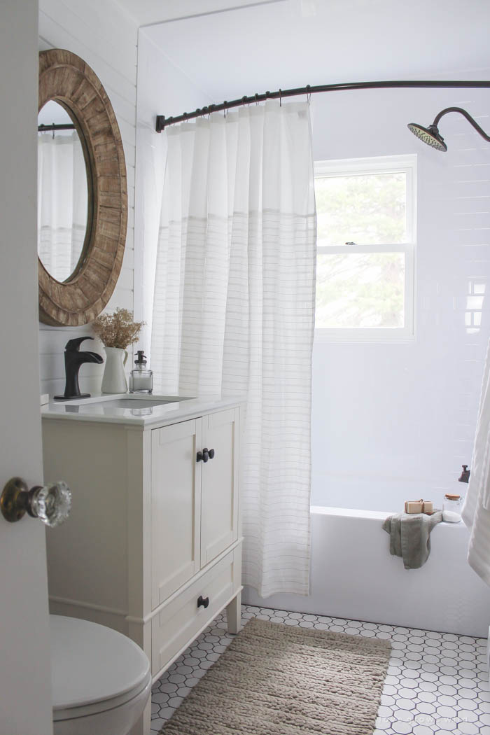 See the big reveal of this beautiful farmhouse bathroom makeover! Click for before and after photos and details at LoveGrowsWild.com