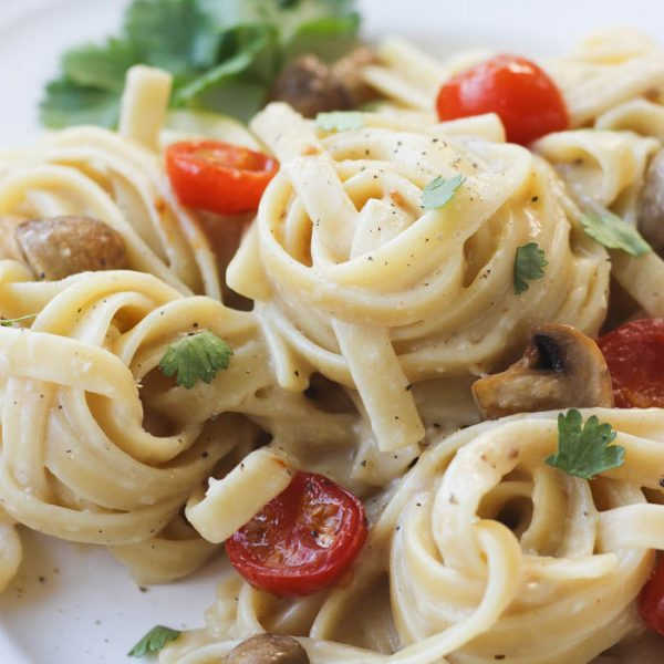 This creamy garlic pasta with delicious roasted vegetables makes a great easy weeknight dinner! | LoveGrowsWild.com