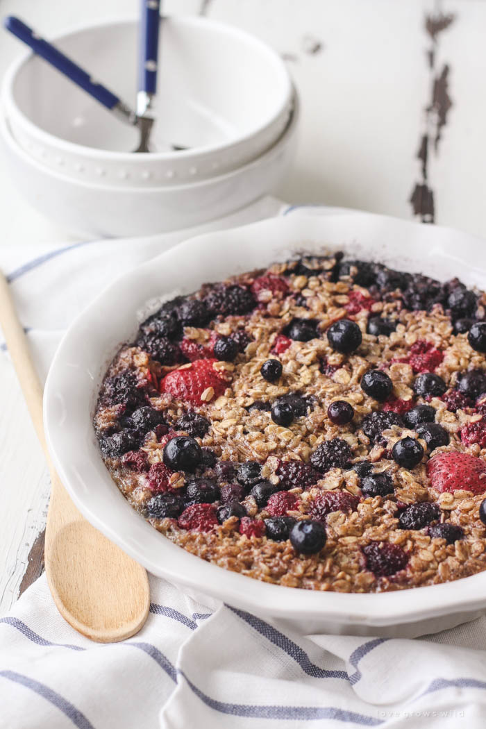 Enjoy a bowl of this warm, delicious Triple Berry Baked Oatmeal for breakfast! Easy to make and baked right in the oven... perfect for serving a crowd! | LoveGrowsWild.com