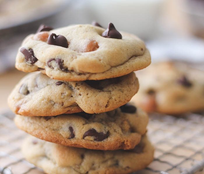 Soft, chewy chocolate chip cookies baked with caramel bits and pecans inside! Get the recipe at LoveGrowsWild.com