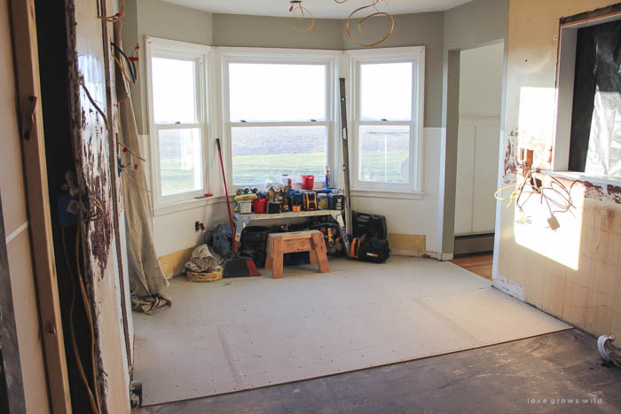 See this gorgeous farmhouse kitchen makeover from start to finish! Find out what it's REALLY like to live through a kitchen renovation!   LoveGrowsWild.com