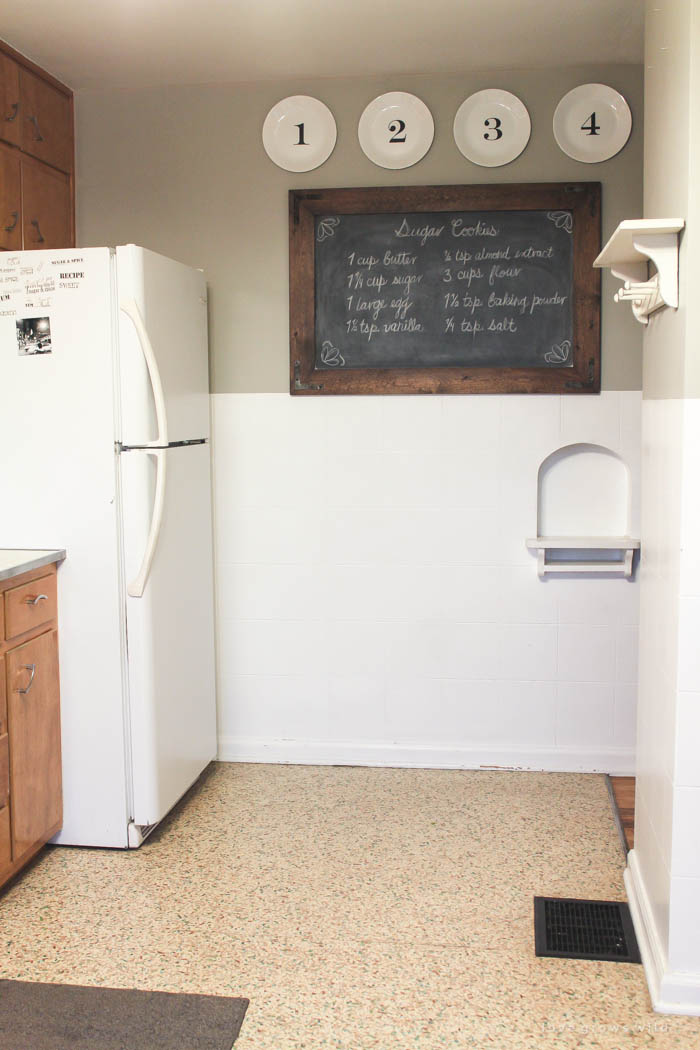 See our plans for turning this dated, dysfunctional space into a gorgeous, modern farmhouse kitchen! More photos and details at LoveGrowsWild.com