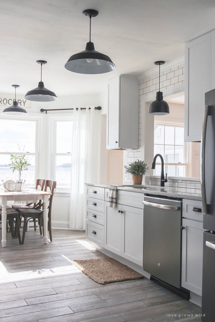 Follow along the makeover of this beautiful farmhouse kitchen! In this post, Liz shares the countertops she picked and why. Click for more photos and details!