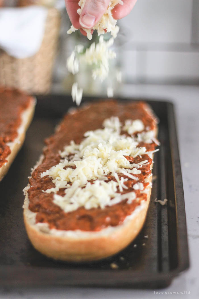 This Toasted Chili Cheese Bread is the perfect quick appetizer and SO delicious! Tons of gooey cheese with a spicy kick of chili! Recipe at LoveGrowsWild.com