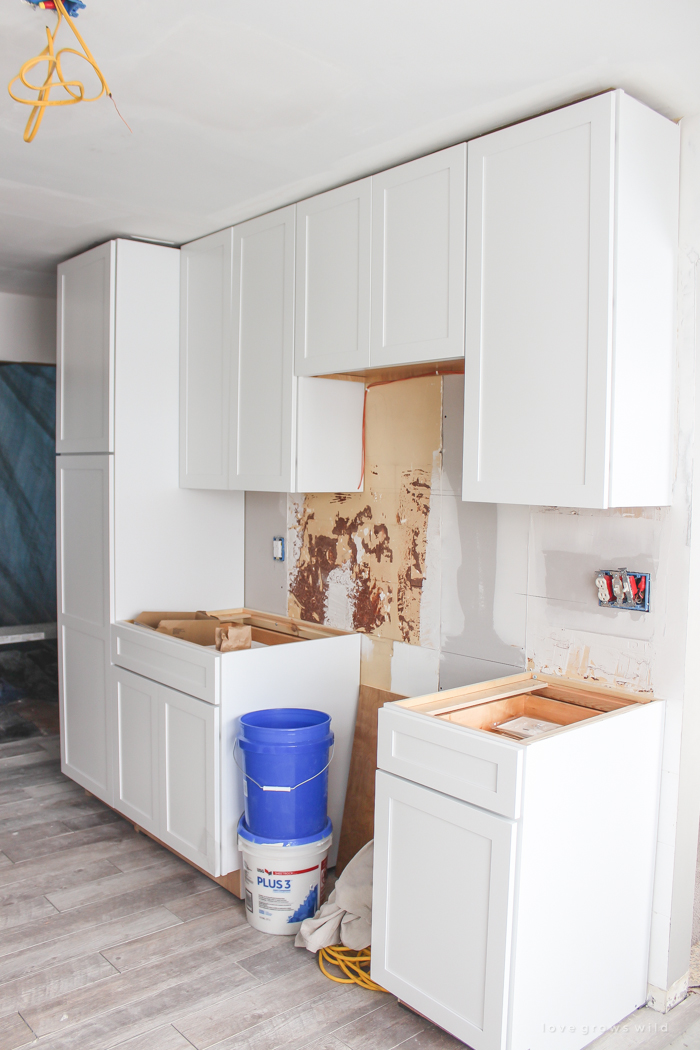 Follow along the makeover of this beautiful farmhouse kitchen! In this post, Liz shares the cabinets and hardware she used. Click for more photos and details!