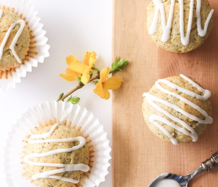 Moist, fluffy Lemon Poppy Seed Muffins baked to perfection with a sweet lemon icing on top! | LoveGrowsWild.com