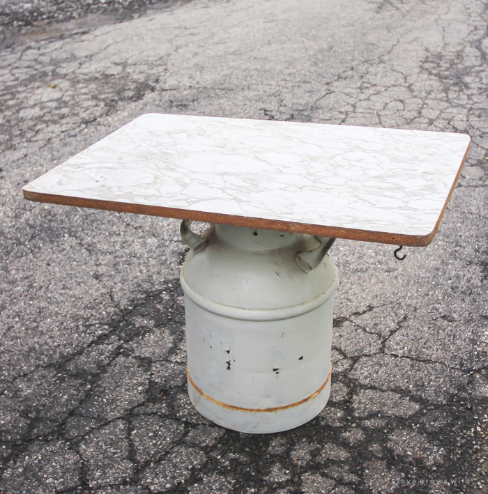 How to turn an old milk can into a gorgeous coffee table! See how this blogger created a unique piece of furniture perfect for her farmhouse at LoveGrowsWild.com