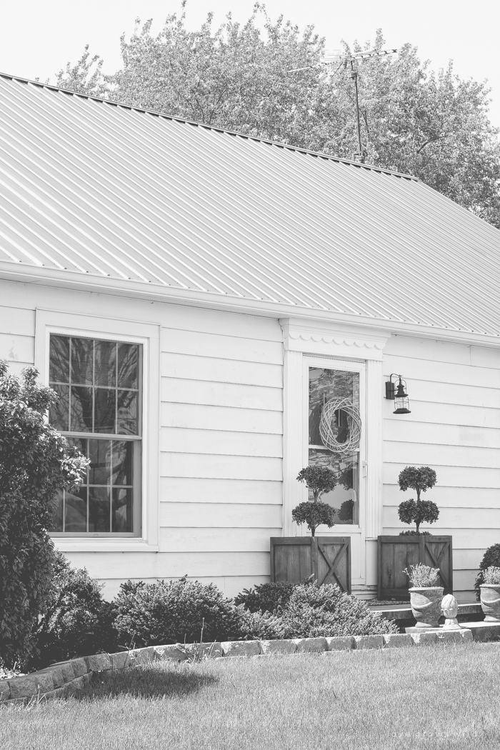 Just because you have a small front porch doesn't mean it can't be big on charm! Get ideas from this beautiful farmhouse at LoveGrowsWild.com