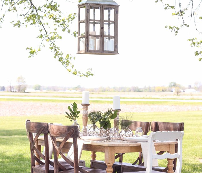 Learn how to create the perfect outdoor table setting with shopping and decorating tips from Liz Fourez. This view of her farm is stunning!