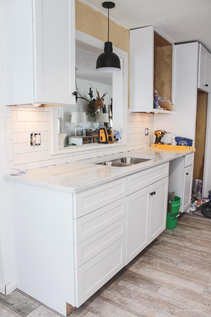 Follow along the makeover of this beautiful farmhouse kitchen! In this post, Liz shares all the finishing touches she picked for lighting, faucets, furniture, and more!