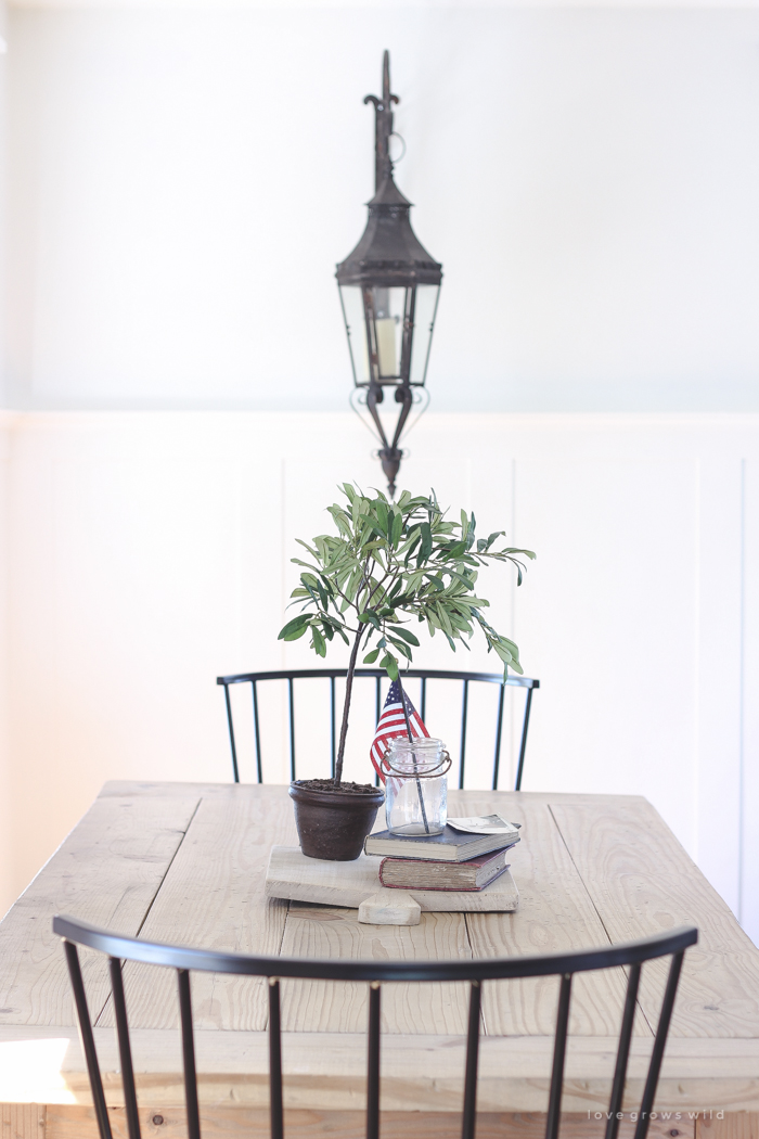Simple touches of red, white and blue give this farmhouse dining room the perfect patriotic feel.