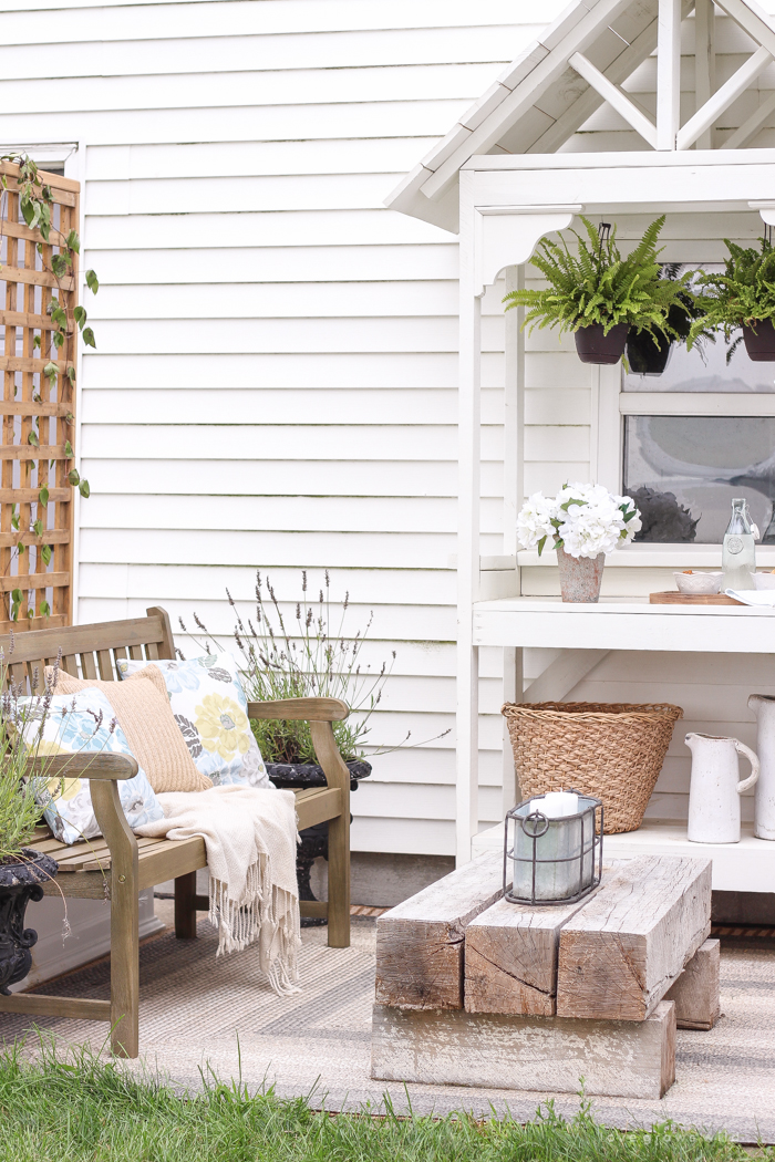 This gorgeous patio is perfect for summer entertaining! Learn how to create a simple, yet stunning outdoor bar cart for your next party!