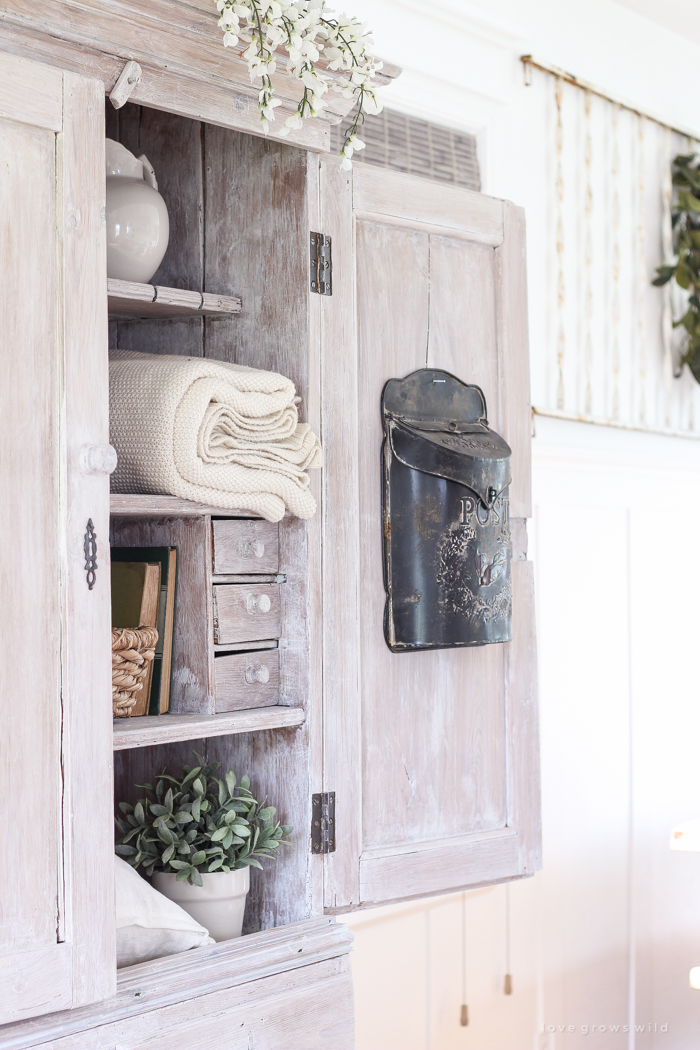 Step inside this beautiful Indiana farmhouse entryway decorated with a mix of timeworn antiques and unique DIY projects!