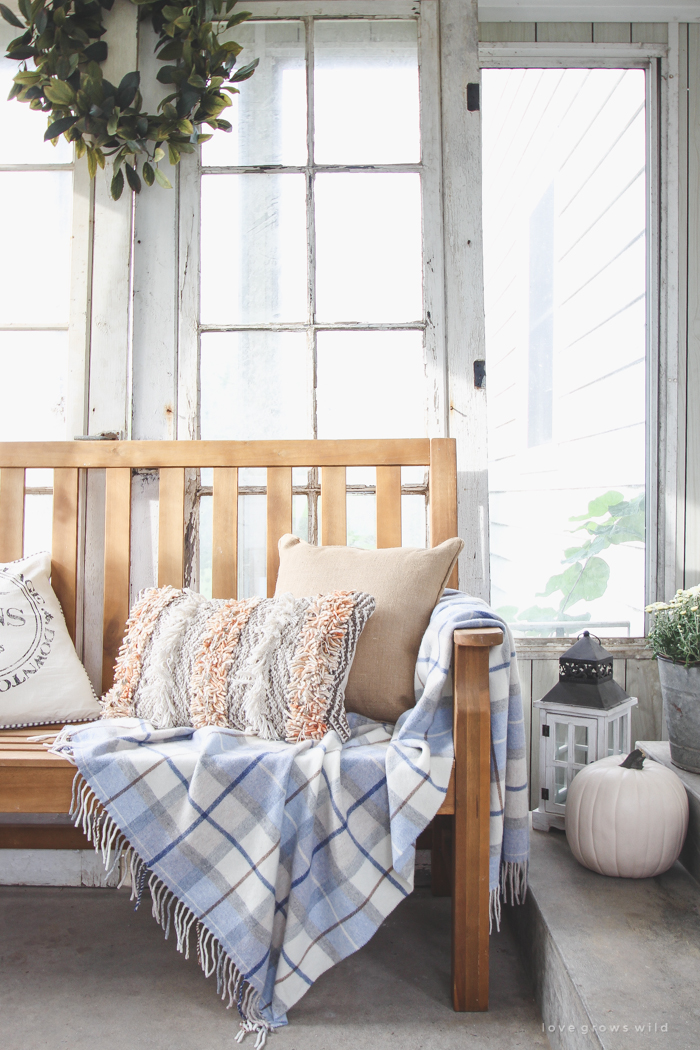 A beautiful farmhouse front porch decorated with simple touches of fall!