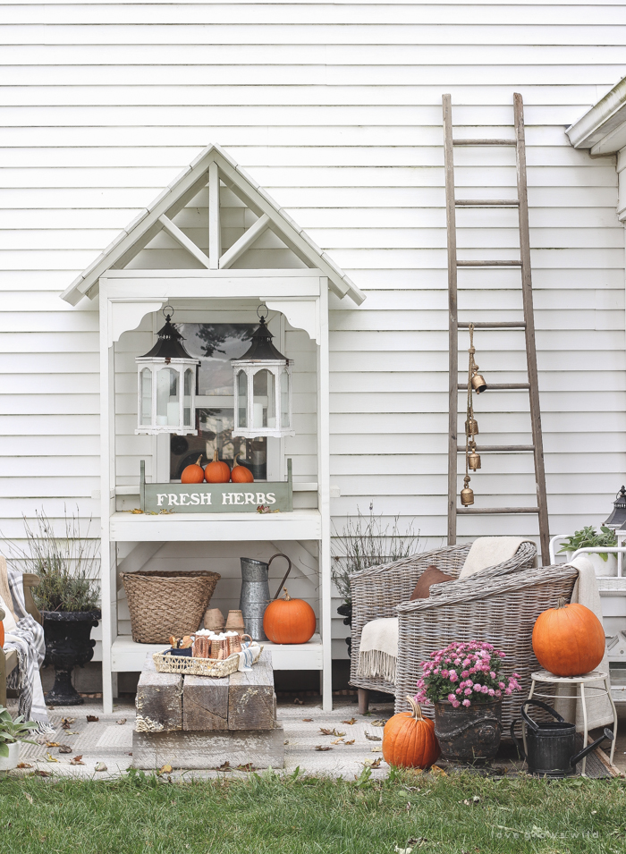A small patio is transformed into a cozy seating area for fall.