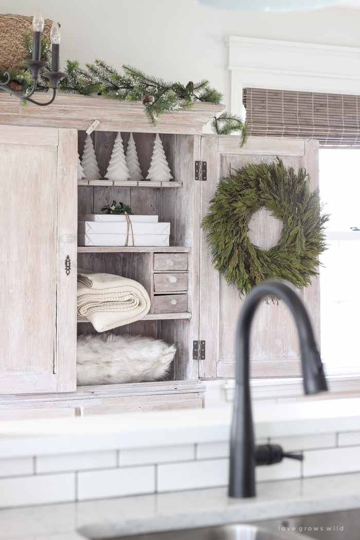 A beautiful farmhouse entryway decorated for the holidays!