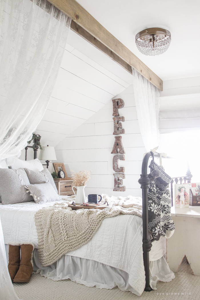 a beautiful farmhouse bedroom decorated for the holidays - How To Decorate Your Bedroom For Christmas