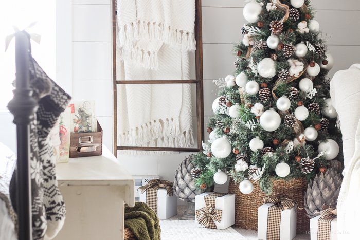 a beautiful farmhouse bedroom decorated for the holidays - Farmhouse Christmas Tree Decorations
