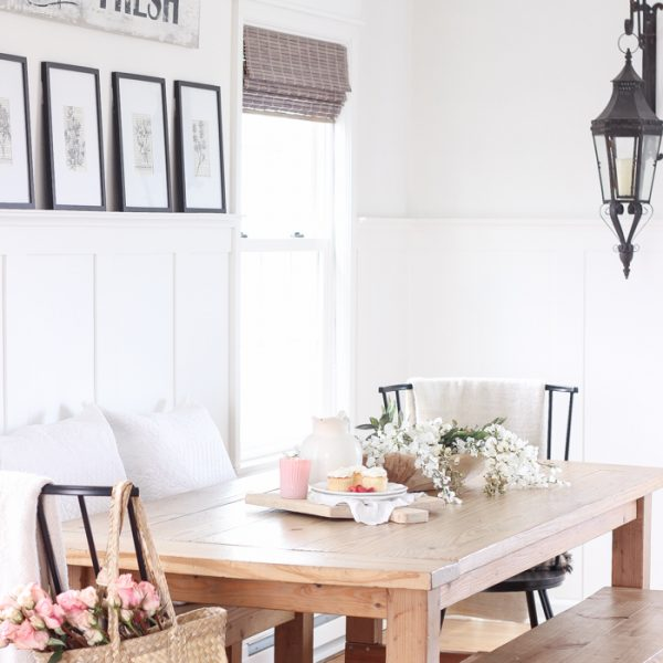 A pretty farmhouse dining room decorated for spring!
