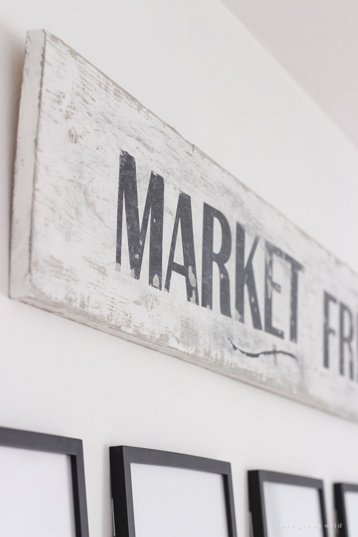 A handmade sign with a beautiful distressed antique finish. Learn how to make this simple and inexpensive DIY vintage Market Fresh sign!