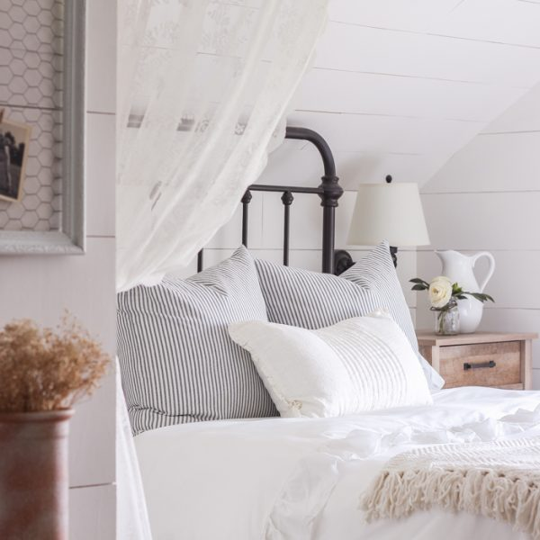 A clean and cozy farmhouse master bedroom with tons of vintage charm