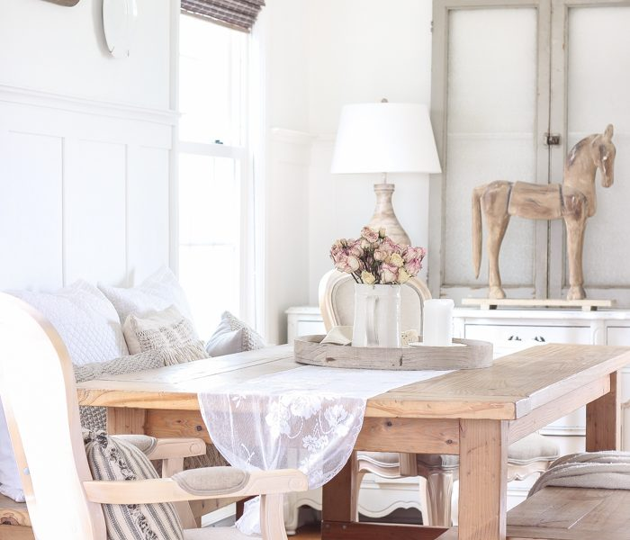 A beautiful farmhouse dining room with a french country twist