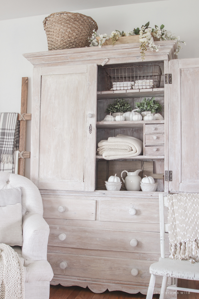 A beautiful farmhouse living room decorated with soft neutrals for fall
