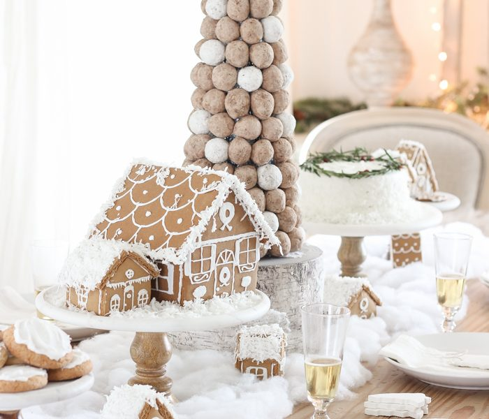 This adorable dessert table is perfect for the holidays and kids! Celebrate Christmas with gingerbread houses, a donut tree, festive cakes, cookies and more!