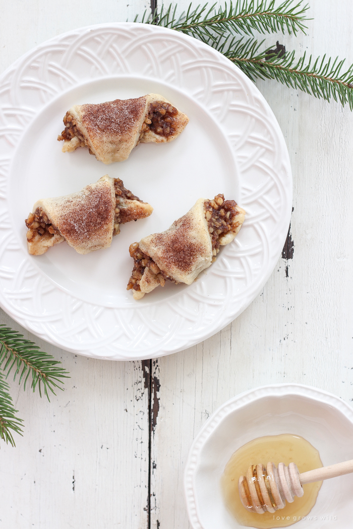 Tender, flaky pastries wrapped with a delicious honey nut filling and sprinkled with a hint of cinnamon sugar on top! These tasty treats are perfect for the holidays or any time of year!