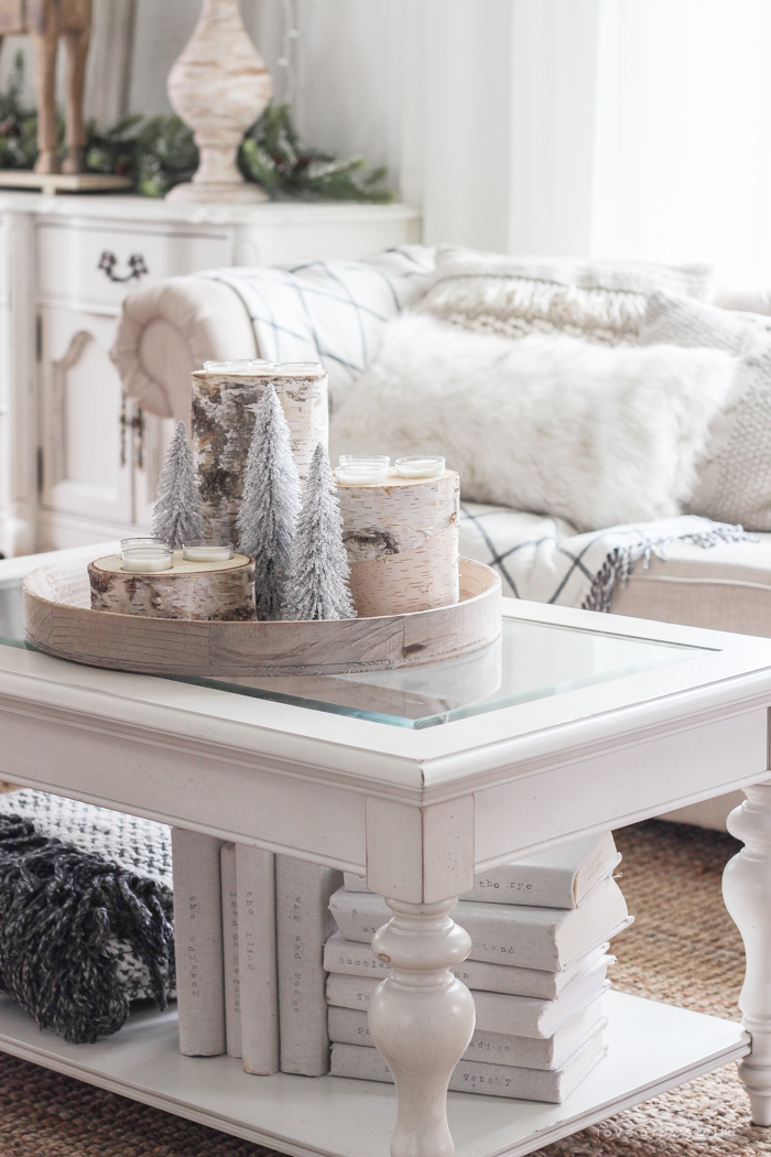 A beautiful farmhouse living room decorated in soft neutrals for the holidays!