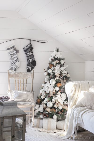 This cozy master bedroom is beautifully decorated for Christmas with soft neutrals and tons of farmhouse charm.