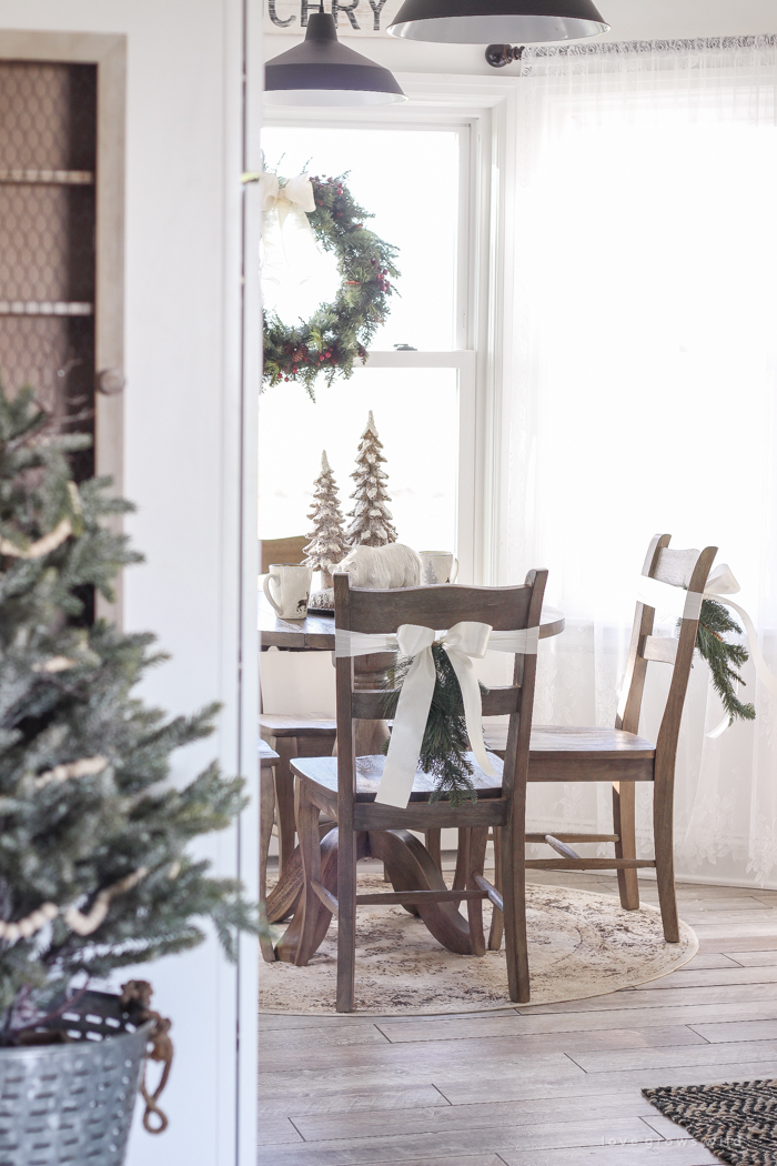 step inside this beautiful farmhouse and discover a winter wonderland themed kitchen decorated for christmas with