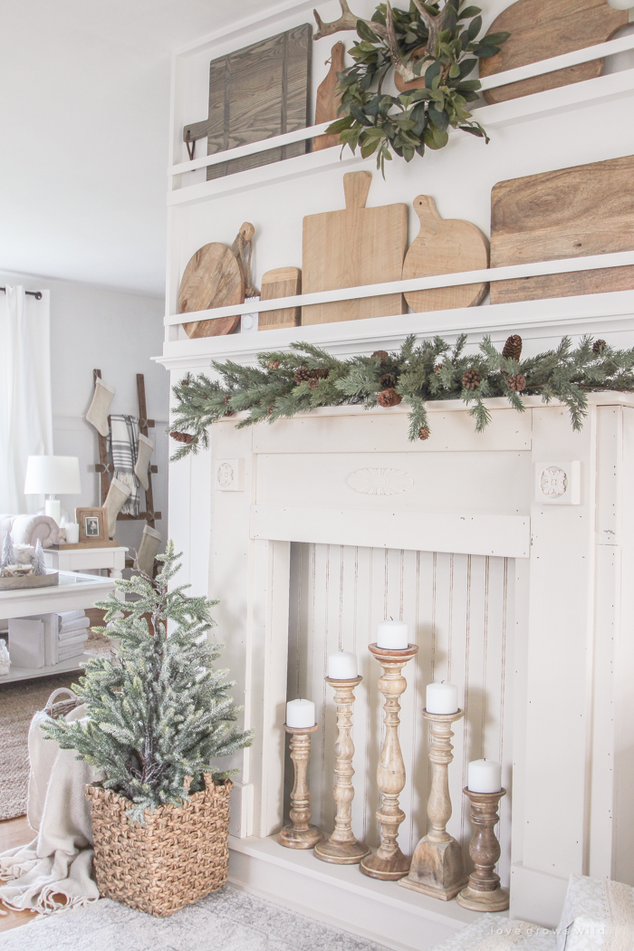 A rustic mantel is given a big makeover for the holidays! See how milk paint transformed this cozy cottage mantel.