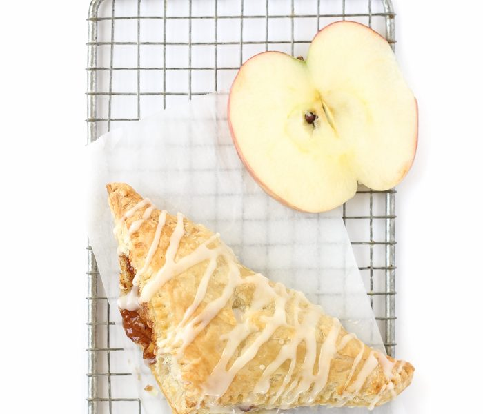Delicious apple turnovers with a flaky pastry crust, apple cinnamon filling, and sweet vanilla glaze