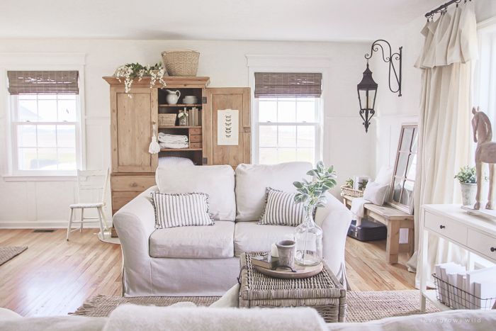 See how this small farmhouse living room transformed and evolved over the years from dark and dated to light, bright and beautiful!