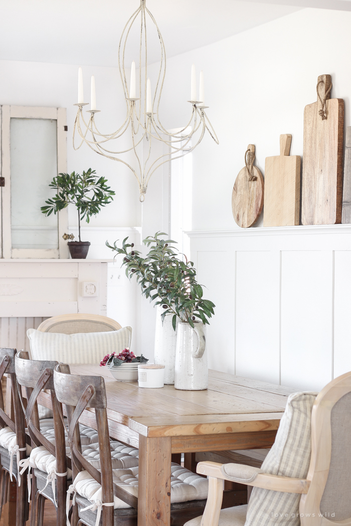This dining room shares space with a living room, but maximizes style and looks stunningly fresh.