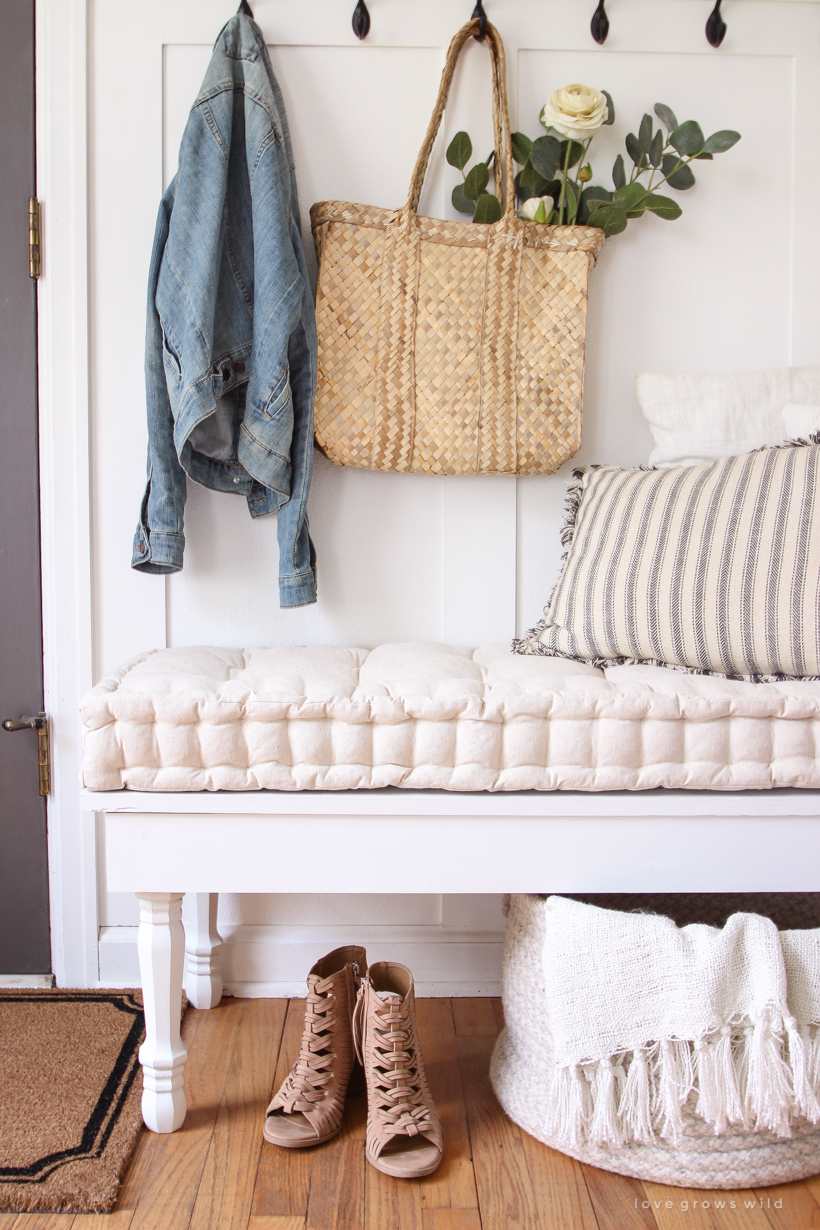 Learn how to make a beautiful custom bench for a bedroom, dining room, or entryway with this easy DIY tutorial!