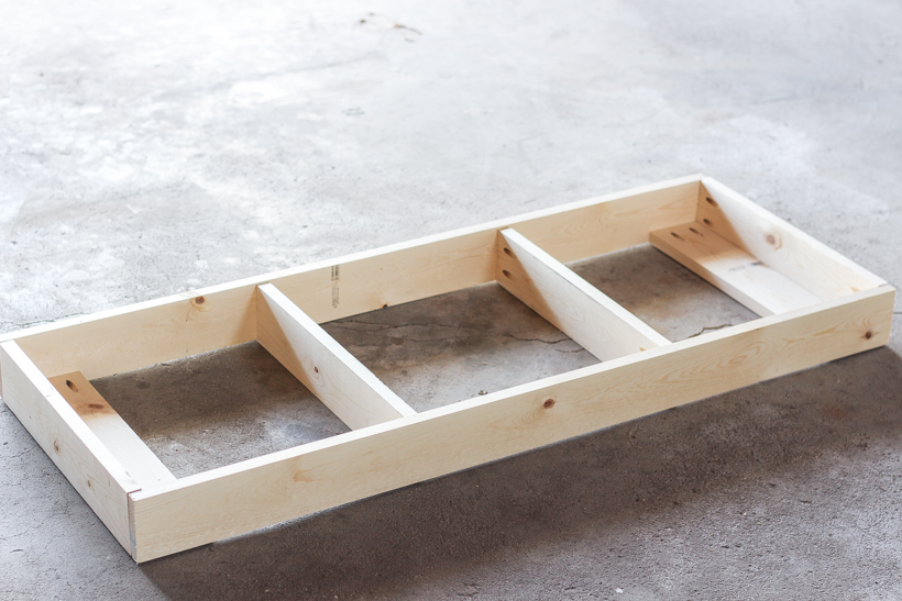 Learn how to build this beautiful custom bench for your entryway, dining room table, or bedroom with this quick and easy tutorial!