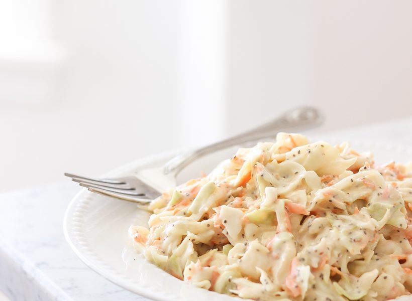 This easy, creamy coleslaw recipe is so good and makes the perfect side dish for picnics and barbecues!