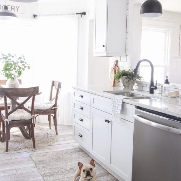 A cozy farmhouse kitchen decorated simply with elements from nature