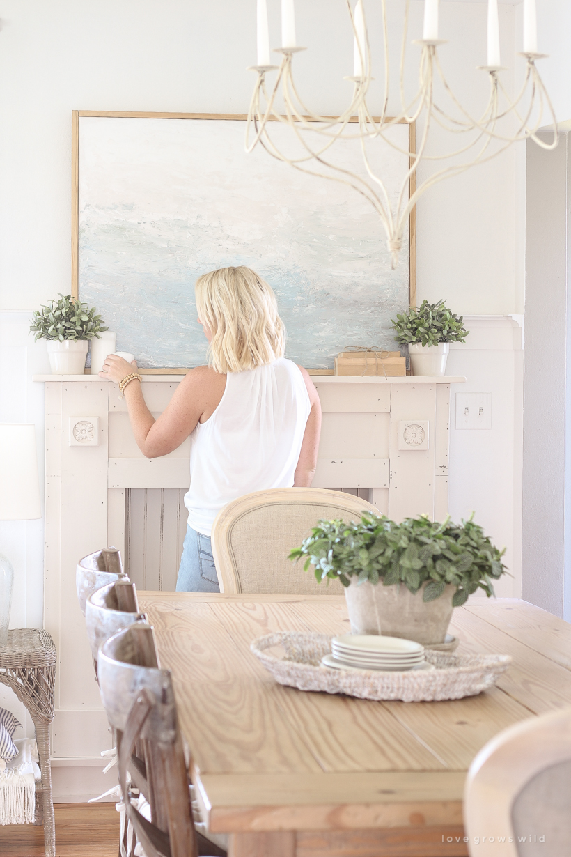 Learn how to decorate on a budget by creating beautiful art for your home with this easy tutorial. Hint... you don't need to be an artist to create art! See the entire process from blank canvas to completed painting using only one tool.
