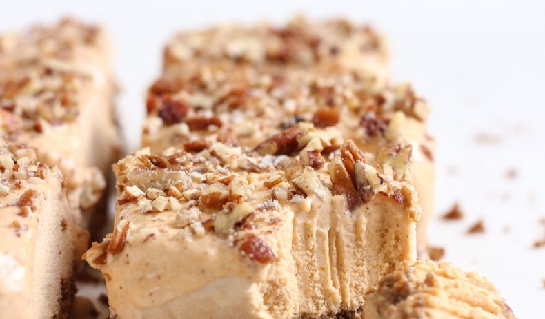 The best flavors of fall turned into a cool, sweet treat! Get the recipe for these easy Pumpkin Ice Cream Bars with a gingersnap crust and pecans sprinkled on top!
