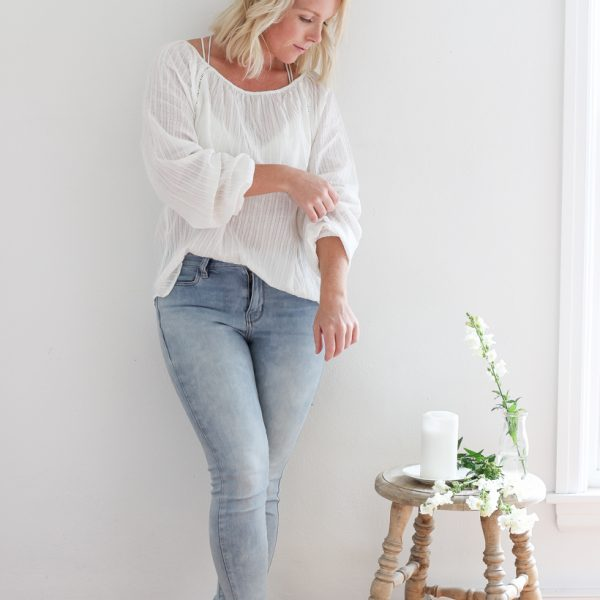 Transition your wardrobe between seasons with these white blouse outfit inspirations