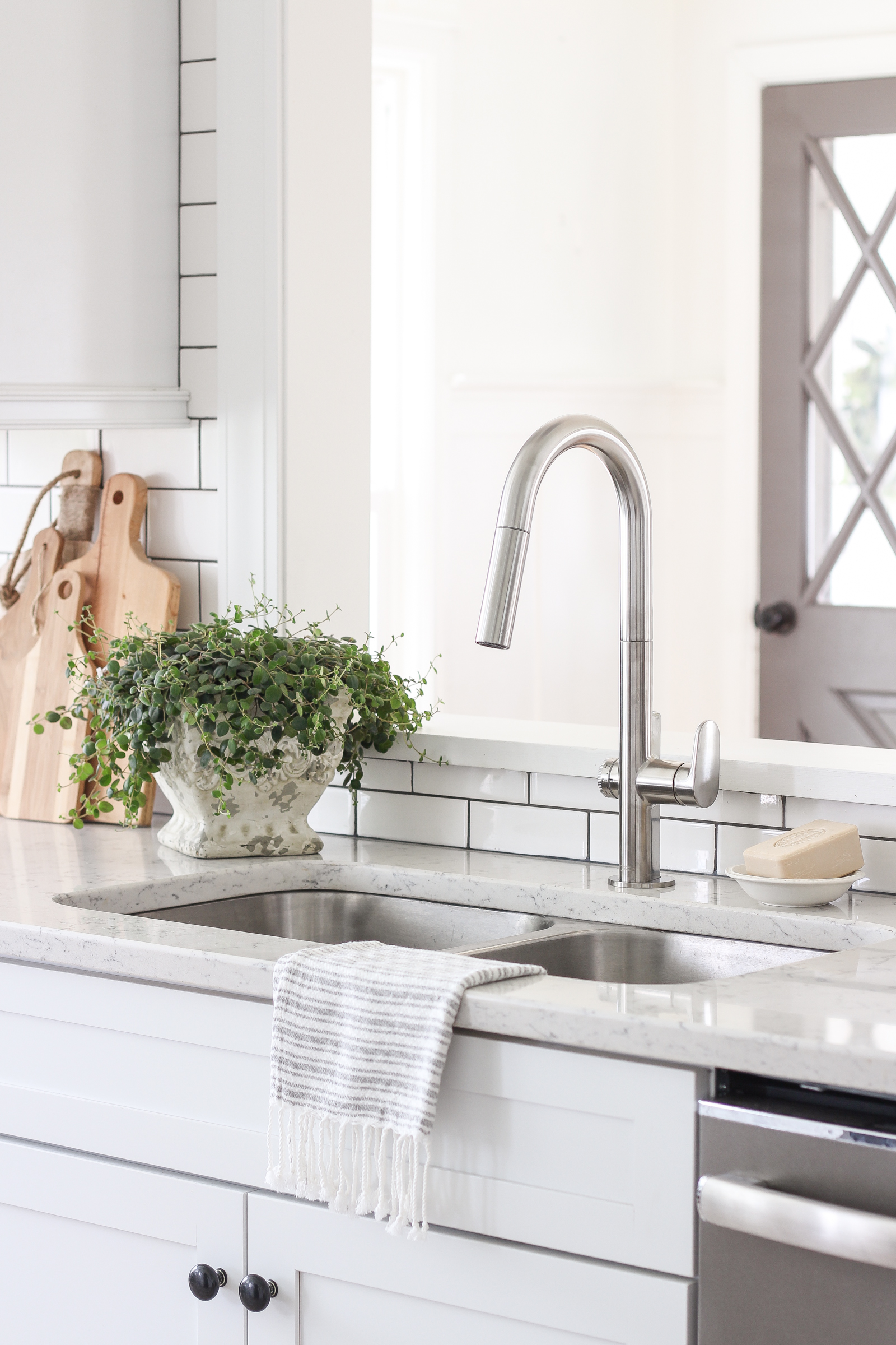 A lovely farmhouse kitchen with a faucet as functional as it is beautiful