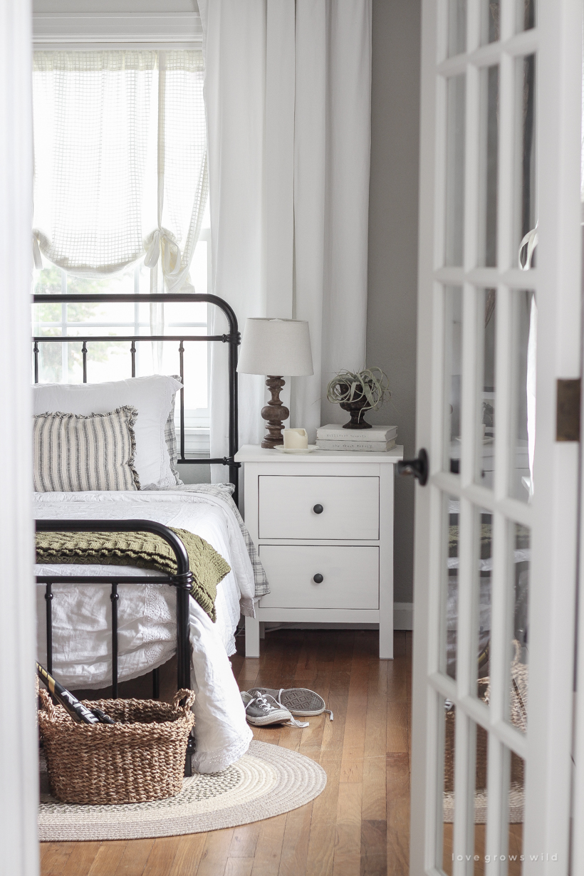 This teenage boy's bedroom is just the right mixture of masculine, simple and cozy.