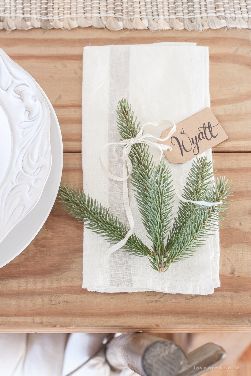 A simple, no fuss Christmas tablescape with fresh greens and beautiful antique metal accents