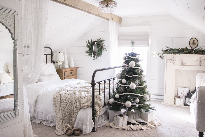 "A simple, cozy bedroom decorated for Christmas with a ""vintage winter wonderland"" theme"