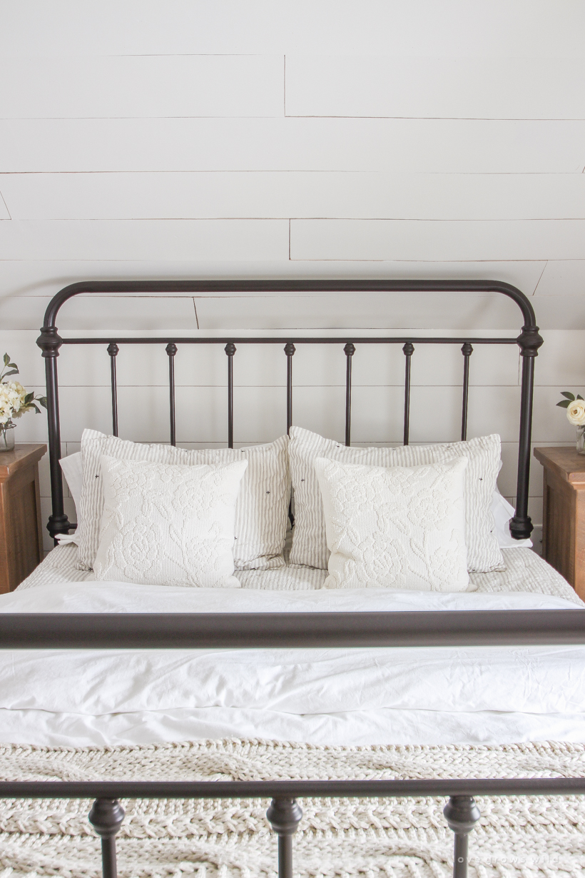 Step inside home and lifestyle blogger Liz Fourez's charming master bedroom with gorgeous farmhouse details and neutral color palette.