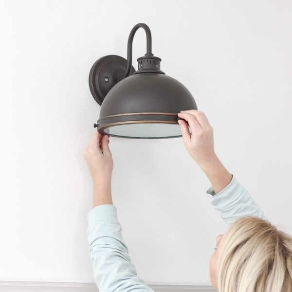 Home and lifestyle blogger Liz Fourez shares an easy trick to install light fixtures anywhere in your home - no wiring necessary!