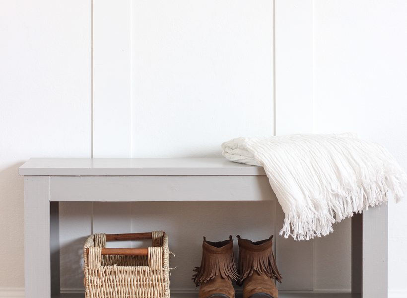 Home and lifestyle blogger Liz Fourez shows how to make a simple bench with storage that would be perfect for an entryway or at the foot of a bed. Follow her easy step-by-step photo tutorial to create this beautiful DIY bench!